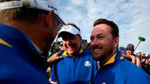 Europe's English golfer Ian Poulter (C) and Europe's Northern Irish vice-captain Graeme McDowell celebrates after winning the 42nd Ryder Cup at Le Golf National