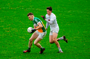 Leon Fox of Offaly attempts to hold off Mick O'Grady of Kildare. Photo: Sportsfile