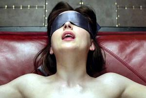 Dakota Johnson in a scene from 'Fifty Shades of Grey' : caning and spanking are banned under the new porn curbs in the UK