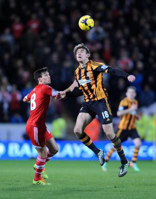 Southampton's Jack Cork (left) and Hull City's Nikica Jelavic in action