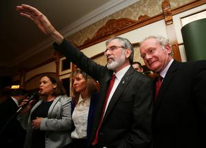 Sinn Fein president Gerry Adams (centre) with Sinn Fein deputy leader Mary Lou McDonald (left) and Northern Ireland Deputy First Minister Martin McGuinness following a press conference at the Balmoral Hotel, Belfast, after his release from custody at Antrim Police Station following questioning  in connection with the murder of mother-of-10 Jean McConville in 1972.