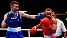 Direct hit: Ireland's Brendan Irvine lands a left hand on Istvan Szaka of Hungary during their flyweight 52kg bout at the Road to Tokyo European Boxing Olympic Qualifying event in London on Monday. Photo: Harry Murphy/Sportsfile