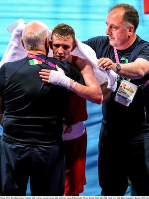 25 June 2015; Brendan Irvine, Ireland, with coaches Gerry Storey, left, and Zaur Antia following his Men's Boxing Light Fly 49kg Final bout with Bator Sagaluev, Russia. 2015 European Games, Crystal Hall, Baku, Azerbaijan. Picture credit: Stephen McCarthy / SPORTSFILE
