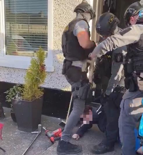 Members of the Emergency Response Unit raid the house in Crumlin