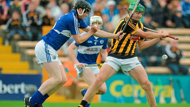 Laois' Denis Cahill tries to get a block in on Daniel O'Connor