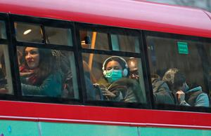 A woman wearing a face mask on a bus in London. Photo: Yui Mok/PA Wire