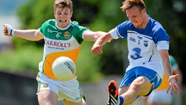 Johnny Moloney tries to put off Waterford's Mark Ferncombe