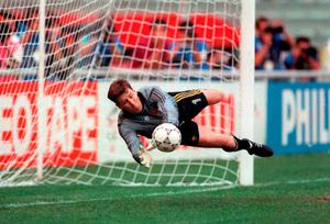Former Ireland goalkeeper Packie Bonner saves a penalty against Romania in Italia 90.