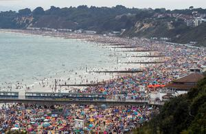 Packed out: People enjoy the sunny weather at Bournemouth beach. Photo: Steve Parsons/PA Wire
