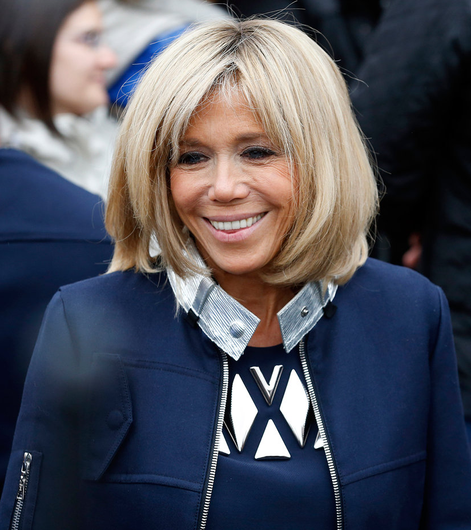 Picture of health: Brigitte Macron in slim-cut navy tailoring Photo: Thierry Chesnot/Getty Images