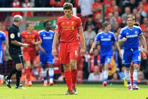 Liverpool's Steven Gerrard appears dejected after his side's defeat to Chelsea at Anfield yesterday