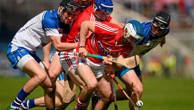 Waterford and Cork players Barry Coughlan, left, Philip Mahony, Luke O'Farrell, Patrick Horgan and Aidan Walsh pursue the sliothar