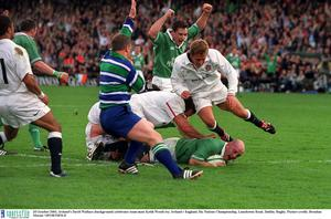 Ireland's David Wallace (background) celebrates team-mate Keith Wood try against England in 2001