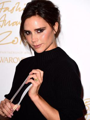 Victoria Beckham with the award for Brand of the Year during the 2014 British Fashion Awards. Photo: Ian West/PA Wire