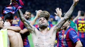 Barcelona's Dani Alves celebrates after winning 3-1 in the Champions League final soccer match between Juventus Turin and FC Barcelona at the Olympic stadium in Berlin