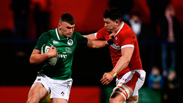 Ben Moxham of Ireland in action against Ioan Davies of Wales. Photo by Harry Murphy/Sportsfile