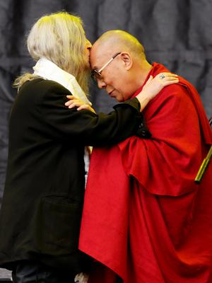 Singer Patti Smith kisses the Dalai Lama, who came on as a guest during her performance, on The Pyramid Stage during the Glastonbury Festival, at Worthy Farm in Somerset