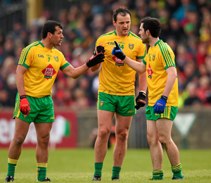 Donegal players Frank McGlynn, Michael Murphy and Mark McHugh in conversation during the game