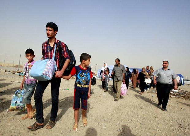 Refugees fleeing from Mosul head to the self-ruled northern Kurdish region in Irbil, Iraq, 350 kilometers (217 miles) north of Baghdad. AP