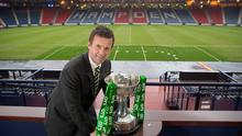 Ronny Deila poses with the Scottish Cup at Hampden Park ahead of Celtic's semi-final clash with Rangers. Photo: Jeff Holmes/Handout/PA Wire