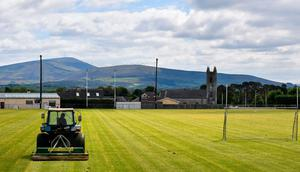 Back in action: Groundsman Austin Kinsella attends to the pitch at Fenagh GAA Club, Co Carlow yesterday in preparation for a return to football and hurling. Photo: David Fitzgerald/Sportsfile