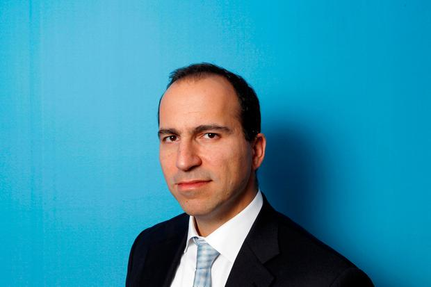 Expedia CEO Dara Khosrowshahi poses for a portrait during the 2010 Reuters Travel and Leisure Summit in New York, U.S. February 22, 2010. REUTERS/Lucas Jackson/File Photo