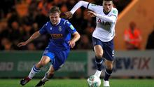 Tottenham Hotspur's Troy Parrott (r) in action against Colchester United's Tom Lapslie during the Carabao Cup third round clash at the JobServe Community Stadium, Colchester.