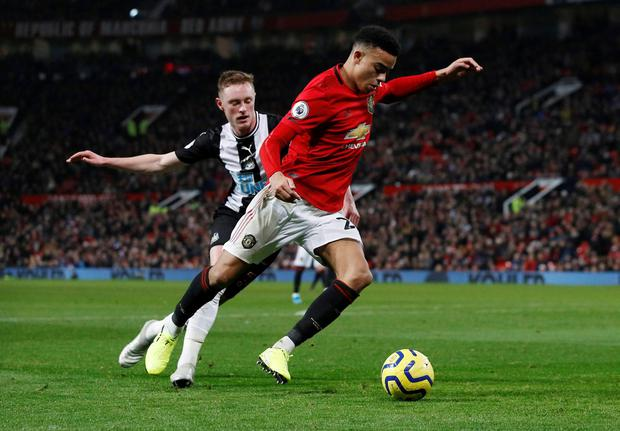 Manchester United's Mason Greenwood in action with Newcastle United's Sean Longstaff. Photo: Phil Noble/Reuters