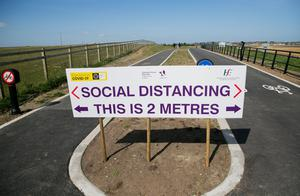 Sign of the times: A social distancing notice on a cycle track in Baldoyle, Dublin 13. Photo: Gareth Chaney