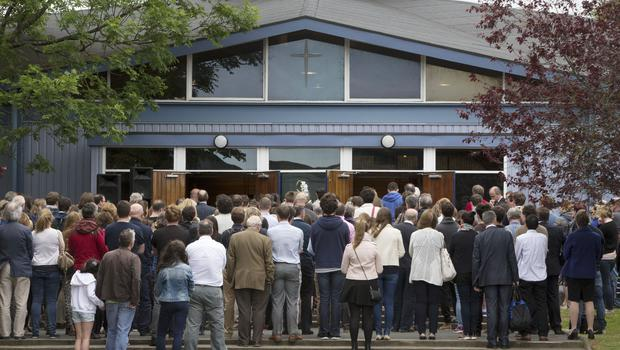 People gather for a mass at UCD this afternoon for the young Irish students who lost thir lives in the Berkeley tragedy. Photo: Mark Condren