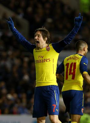 Arsenal's Tomas Rosicky celebrates after scoring his side's third goal of the game during the FA Cup Fourth Round match at the AMEX Stadium, Brighton. PRESS ASSOCIATION Photo. Picture date: Sunday January 25, 2015. See PA story SOCCER Brighton. Photo credit should read: Gareth Fuller/PA Wire. RESTRICTIONS: Editorial use only. Maximum 45 images during a match. No video emulation or promotion as 'live'. No use in games, competitions, merchandise, betting or single club/player services. No use with unofficial audio, video, data, fixtures or club/league logos.