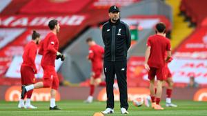 Jurgen Klopp looks on as his liverpool team warms up ahead of the Premier League match against Crystal Palace at Anfield last Wednesday. (Photo by Shaun Botterill/Getty Images)