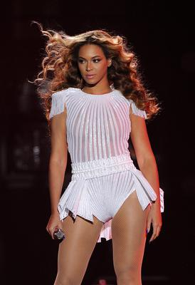 """Beyonce in a custom, hand beaded white peplum one-piece by designers Ralph & Russo on the opening night of her """"Mrs. Carter Show World Tour"""
