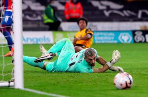 Crystal Palace goalkeeper Vicente Guaita watches a shot from Wolves' Adama Traore go wide. Photo: PA