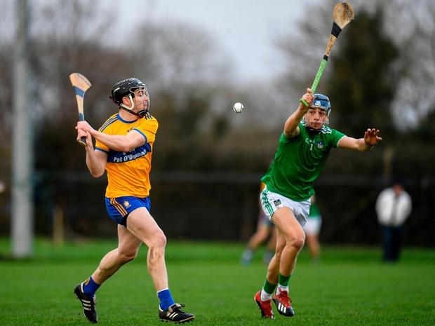 Clare's Tony Kelly is closed down by David Reidy of Limerick. Photo: Harry Murphy/Sportsfile