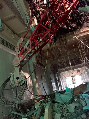 Part of a construction crane is seen coming through the ceiling of the Grand Mosque, in Mecca, Saudi Arabia, early Saturday morning, Sept. 12, 2015.  The towering construction crane toppled over on Friday during a violent rainstorm in the Saudi city of Mecca, Islam's holiest site, crashing into the Grand Mosque and killing over a hundred people, ahead of the start of the annual hajj pilgrimage later this month. (AP Photo)