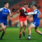 Tyrone's Michael O'Neill in action against Niall Kearns and Dessie Ward of Monaghan during the Bank of Ireland Dr McKenna Cup final at Athletic Grounds in Armagh. Photo: Oliver McVeigh/Sportsfile