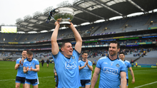Dublin's Brian Howard, with Michael Darragh Macauley alongside, with the Delaney Cup after the Leinster GAA Football Senior Championship Final match between Dublin and Meath at Croke Park in Dublin. Photo by Ray McManus/Sportsfile