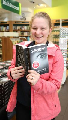 Natalia Tyrakowska, 19, from, Dublin, buys a copy of E.L. James' new Grey; Fifty Shades of Grey book at Easons in O'Connell St, Dublin