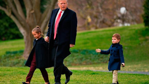 US President Donald Trump makes his way to board Marine One with grandchildren Arabella Kushner (L) and Joseph Kushner, from the White House in Washington, DC, on March 3, 2017.