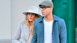 Blake Lively and Ryan Reynolds hold hands as they take a stroll together. Picture: Splash News