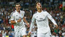 Real Madrid's Cristiano Ronaldo celebrates with Gareth Bale during a Spanish La Liga soccer match between Madrid and Elche at the Bernabeu.