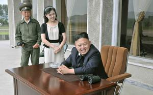 Kim Jong-un (front) and his wife Ri Sol-ju pay a visit to Unit 1017 of the Korean People's Army (KPA) Air and Anti-Air Force. He was honoured with the title of O Jung Hup-led 7th Regiment.