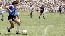 Diego Maradona prepares to score his second goal past goalkeeper Peter Shilton in the 1986 World Cup quarter-final between Argentina and England. Photo: Getty Images