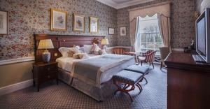 A Liffey Wing Deluxe Interior bedroom at the K Club.