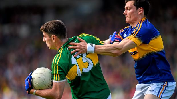 14 June 2015; Paul Geaney, Kerry, in action against Ciaran McDonald, Tipperary. Munster GAA Football Senior Championship Semi-Final, Kerry v Tipperary. Semple Stadium, Thurles, Co. Tipperary. Picture credit: Ray McManus / SPORTSFILE