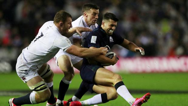 Scotland's Adam Hastings in action with England's George Ford and Sam Underhill. Photo: Lee Smith/     Action Images via Reuters