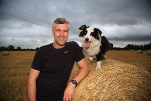 Sitting pretty: Graham Harris with his dog Ruby Photo: Mark Condren