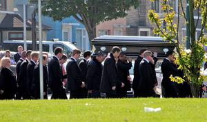 The body of Gerard 'Hatchet' Kavanagh, who was shot dead in Harmons Irish Bar in the Costa del Sol, Spain two weeks age is carried into the Church Of Our Lady Of Good Council , Drimnagh this morning for his funeral mass. Picture Colin Keegan, Collins Dublin.