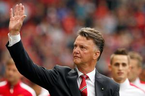 Manchester United's manager Louis Van Gaal waves as he leaves the pitch following their English Premier League soccer match against Queens Park Rangers at Old Trafford in Manchester, northern England September 14, 2014.  Reuters/Andrew Yates